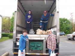 "Volunteers unload donations from a KANE trailer during last year's ""Stamp Out Hunger"" food drive."