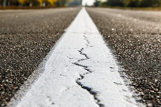 crumbling-road-infrastructure-357930899